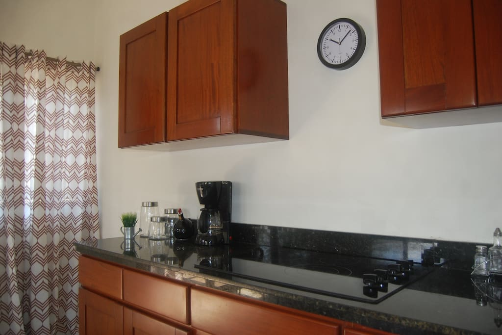 Kitchen with Coffemaker, Stove, Microwave and lot more.