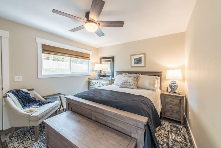 Get cozy in the master bedroom, furnished with a queen bed.