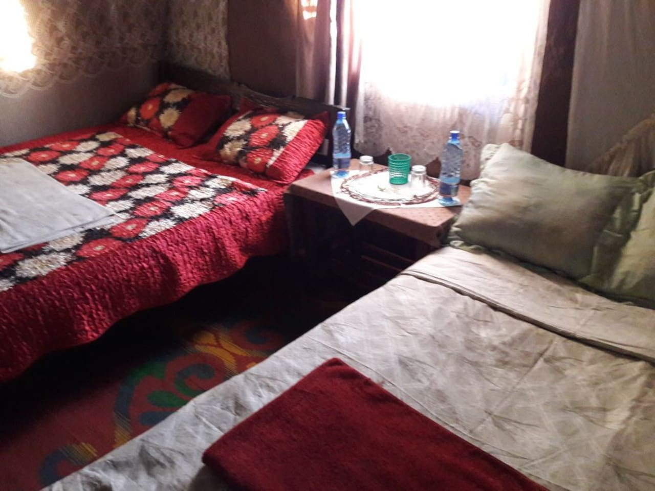 Large room with two double beds and end table and desk. Comes with mosquito nets. All linens provided.