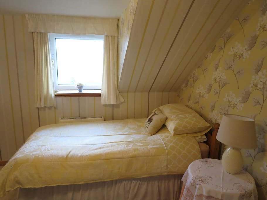 Single bed under the window in bedroom 1 with views of Loch Roag