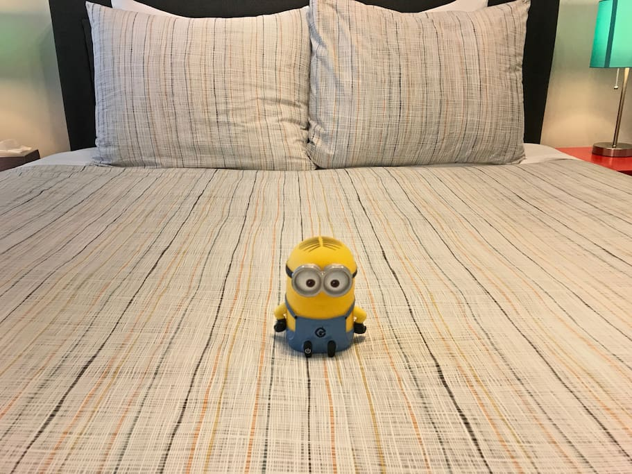 Bedroom with Queen bed and our luxury mattress, high thread count sheets, and luxury pillows. Hey is that a Minion there too? ;)