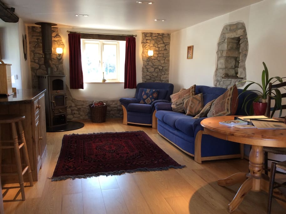 Lounge area with views to the gorge, a lovely wood burning stove