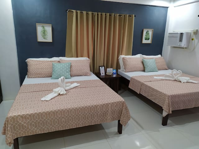 """Master's Bed room  2 Queen Size Beds Air conditioning room 43"""" TV with cable channels  Balcony with table and chairs  Toilet and Bath Hot water Closet WIFI Bluetooth speaker"""