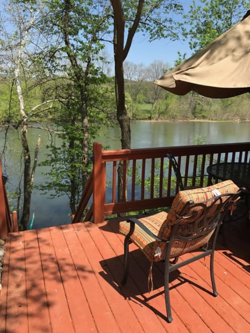 River is mere steps away. Step out of screened porch, onto side deck, and down the steps.
