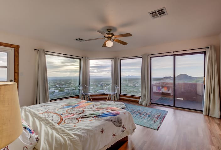Large kind bed in the master bedroom upstairs is great to watch sunsets or lightning storms!