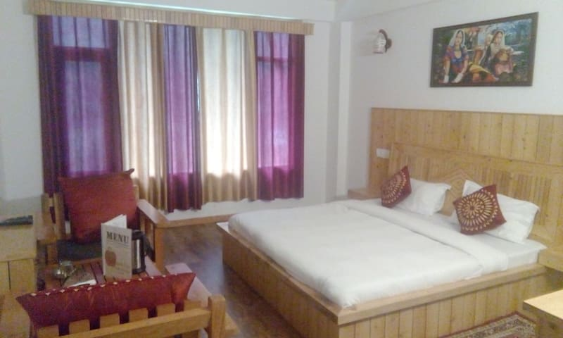 A BedRoom with Mountain's View at-Kothi manali