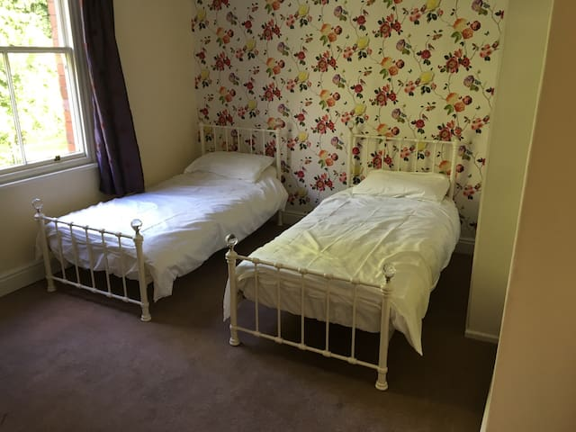 Bedroom contains two twin beds that can be pushed together.