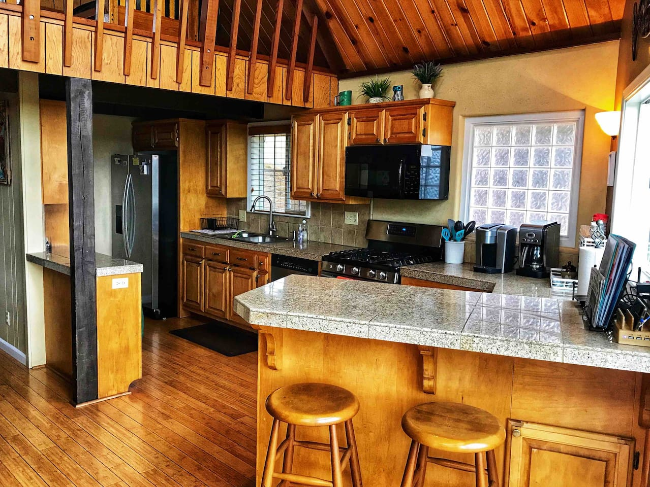 Enjoy cooking for the crew in this fully stocked kitchen with all gadgets for your cooking needs. There is also a 5 device charging station on the counter.