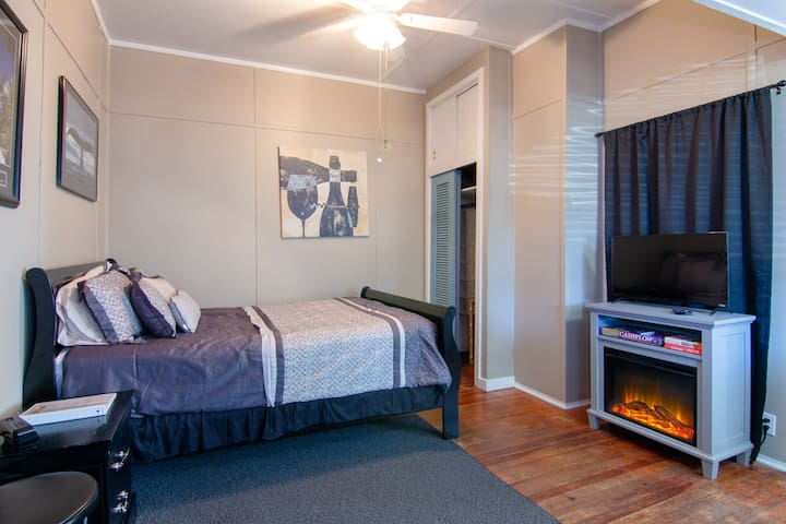 """Queen size bed with fireplace and TV.  """"Lovely old house in a historic neighborhood that was wonderful to walk down through to the old city"""".  - Brett"""