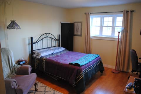Large bedroom with double bed and satellite TV.