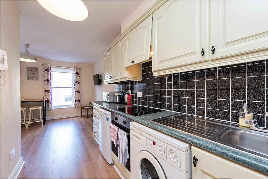 Open plan bright leaving room , wooden floors throughout apartment