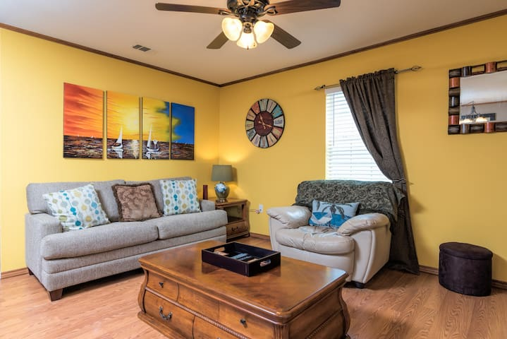 This condo features inviting warm colors and hardwood floors.