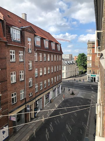 View from living room. Amagerbrogade is at the end of the road, just 20 meters from the apartment.