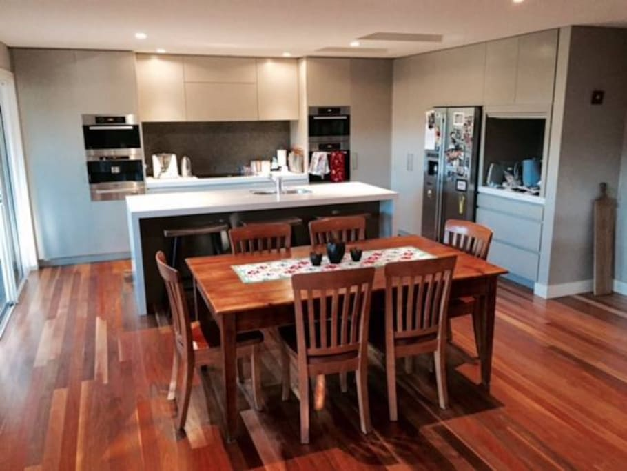 Miele kitchen appliances, easy entertaining area and dining