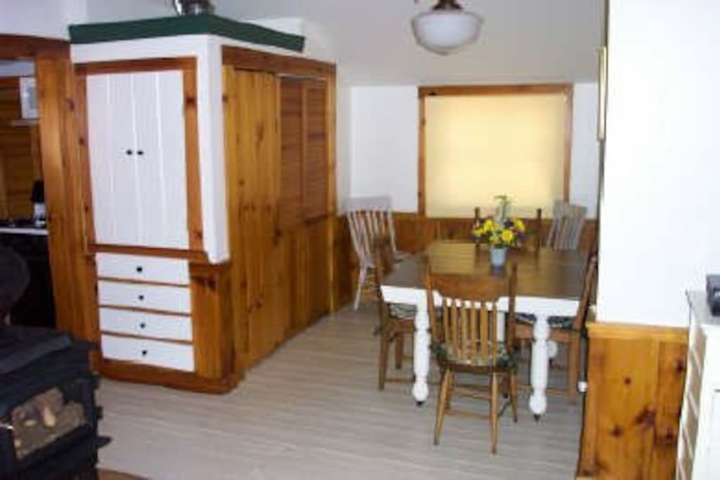 dining room with laundry behind doors