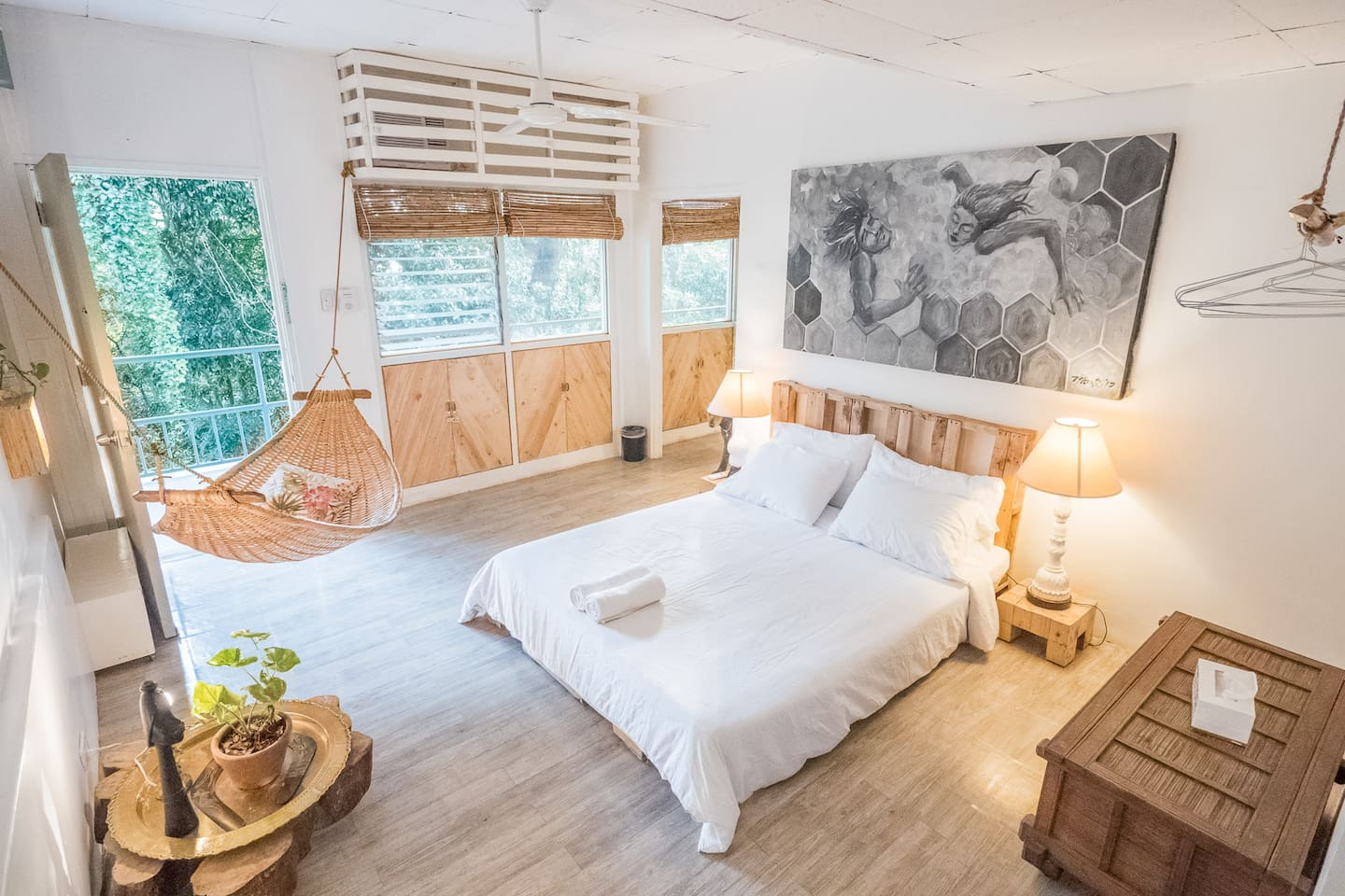 The bedroom of our Forest Nest looks out to a shared hallway with a partial view of Triboa Bay