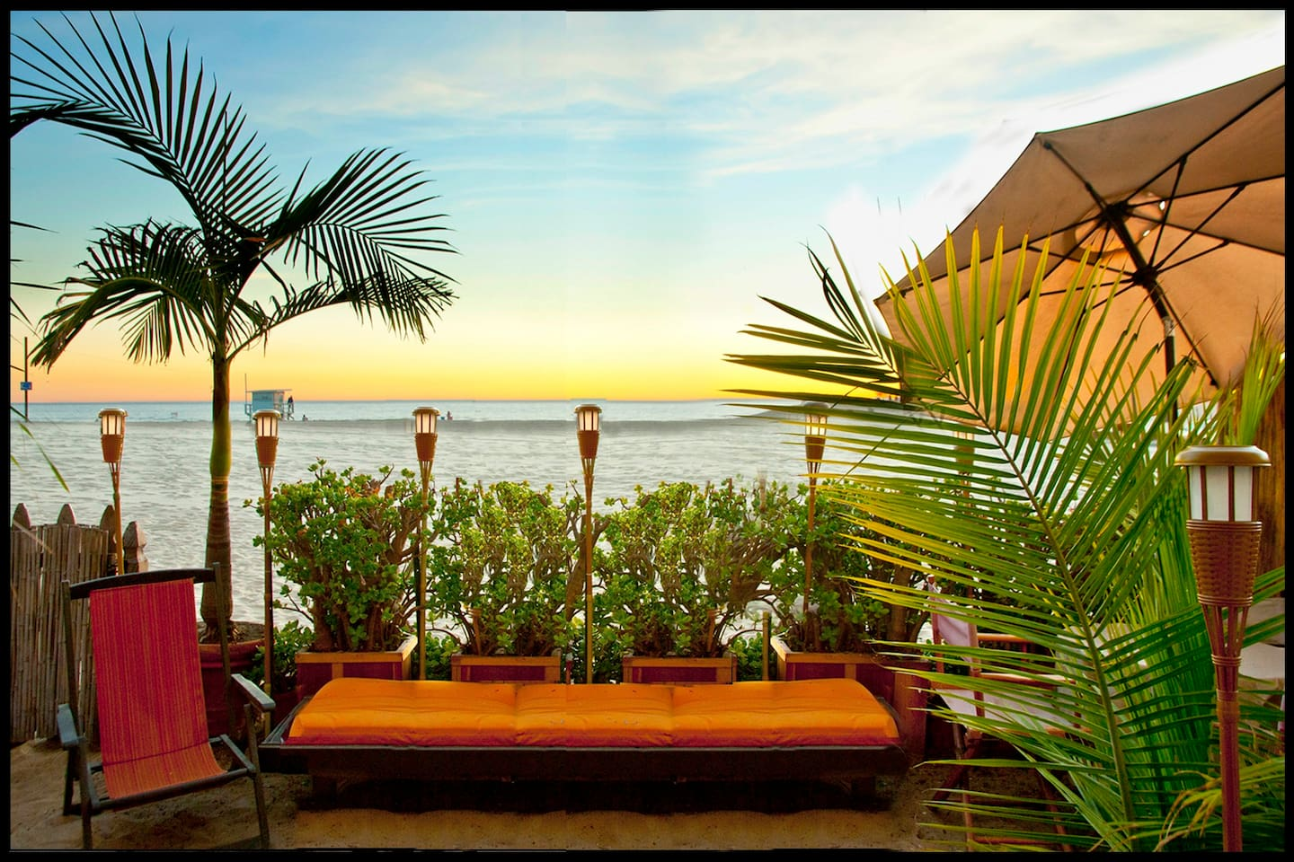 Step right onto the sand and enjoy our tropical beachfront patio, sun lounge chairs and dining tables.
