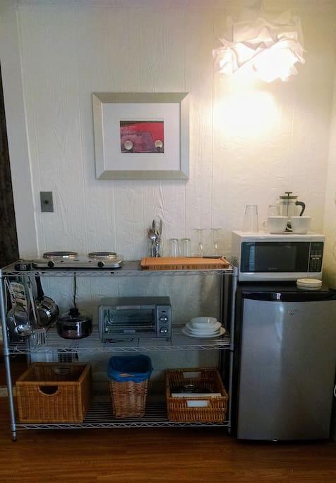 Efficiency kitchen includes 2-burner stove, mini-fridge, toaster oven and microwave