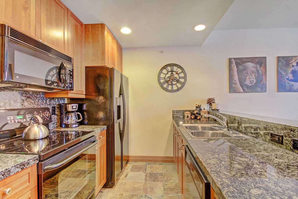 Galley kitchen with granit counters