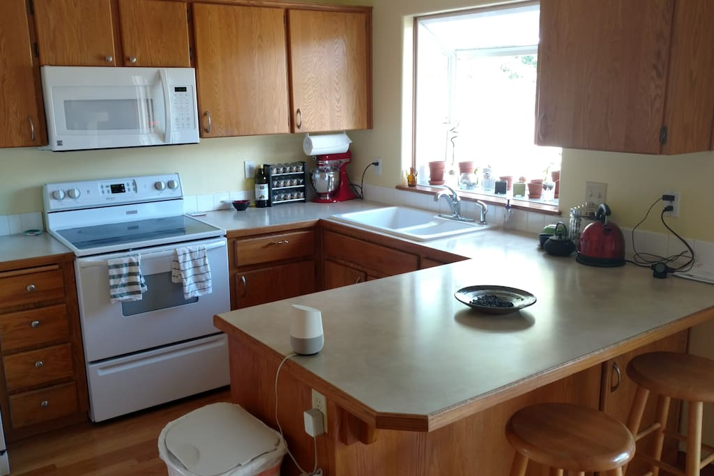 This is our kitchen. Help yourself to tea or coffee.