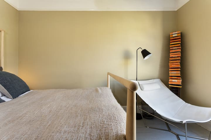 This calming bedroom is bright and comfortable.