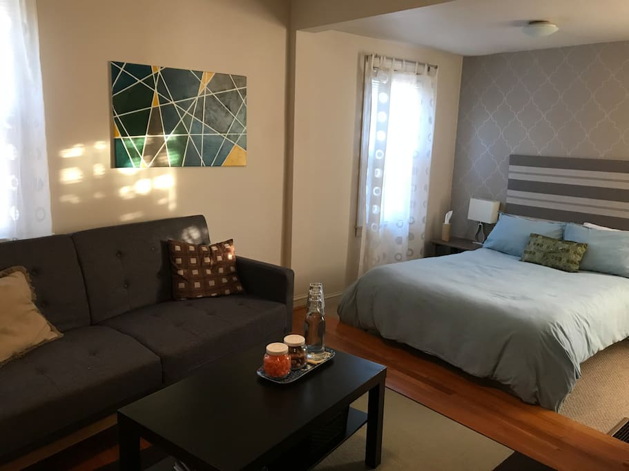 Comfortable sitting area & full-size bed with memory foam mattress