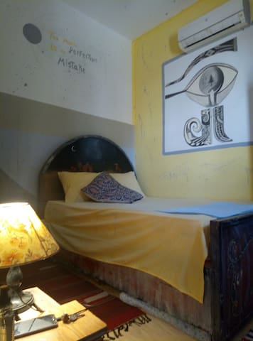 queen size bed with some Bedouin vibes painted on it