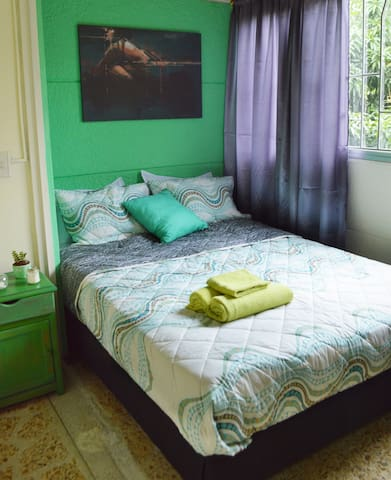 Room # 5 Counts with a set of comfortable and clean sheets, double-size bed,one night stand , big window , closet,fan and mirror