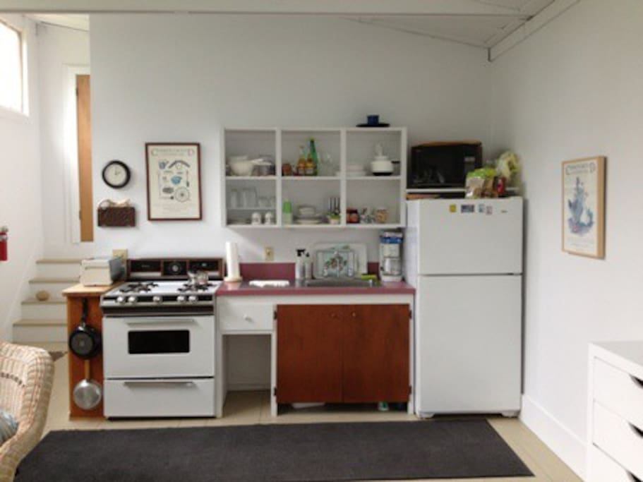 Kitchen with full size refrigerator & stove.