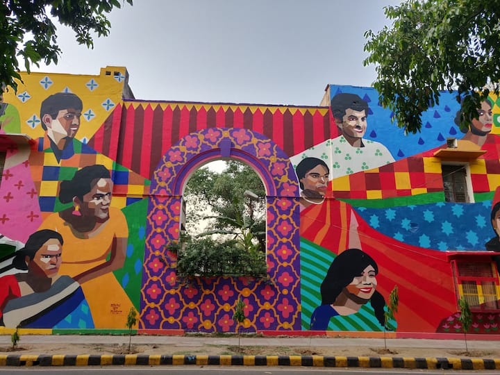 A mural done by women reflecting colors