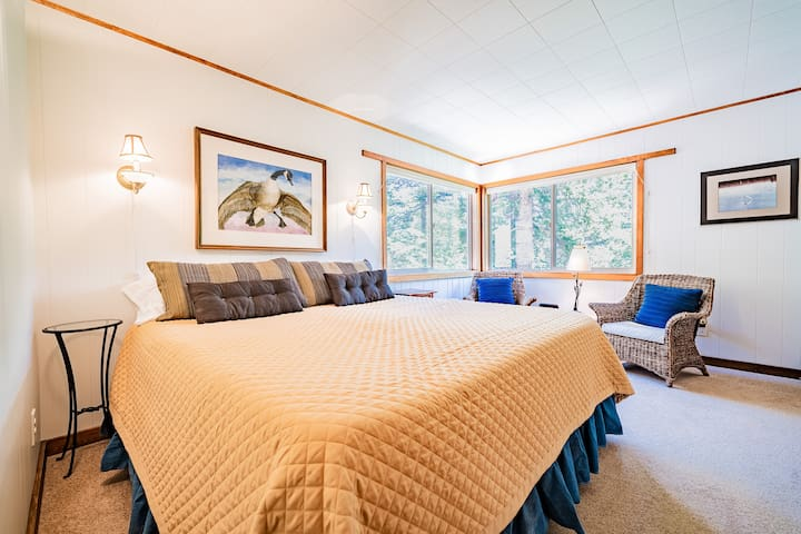 """The first floor king bedroom is spacious and offers additional seating beneath the windows. Note that despite it being """"first floor"""", it's still an extra floor to the ground -- so you feel like you're in the forest canopy."""