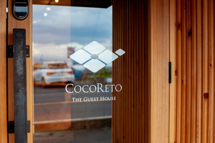 COCORETO The Guest House' entrance, with logo mark.
