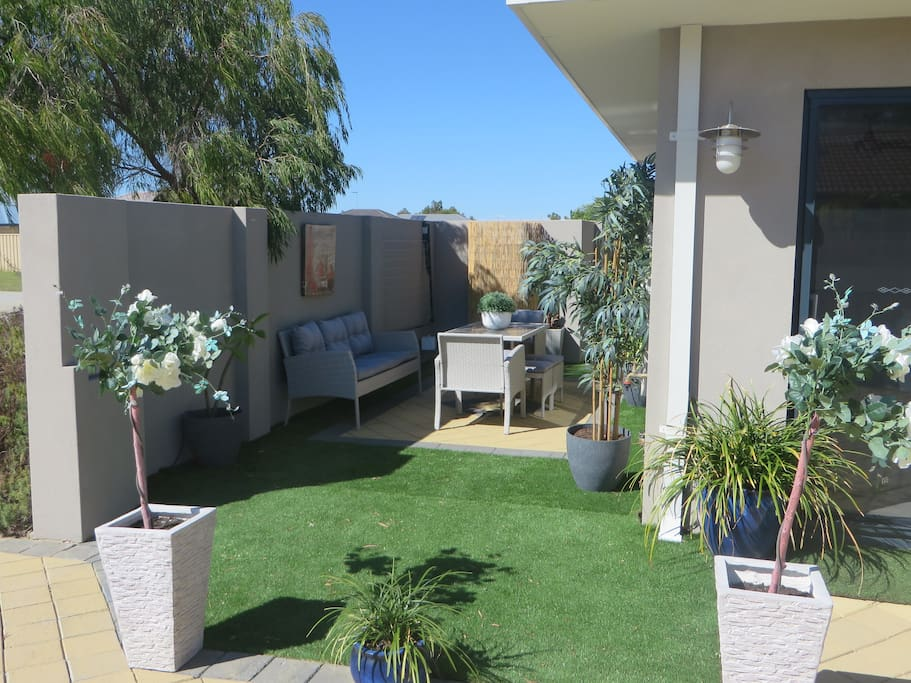Courtyard and BBQ area beside front door and overlooked from lounge/dining