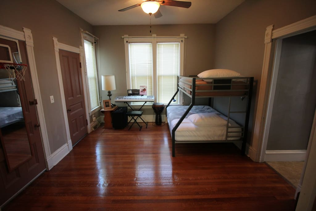 Full and twin bunk bed. This room gains privacy by closing the pocket doors
