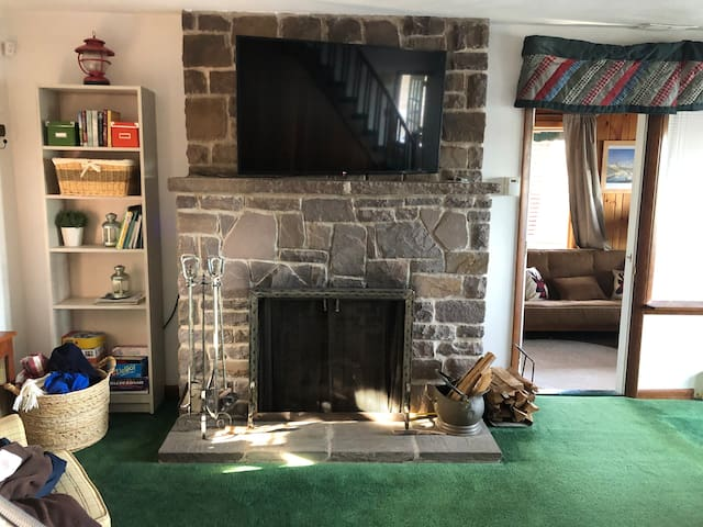 View of the fire place and TV in the main living room.