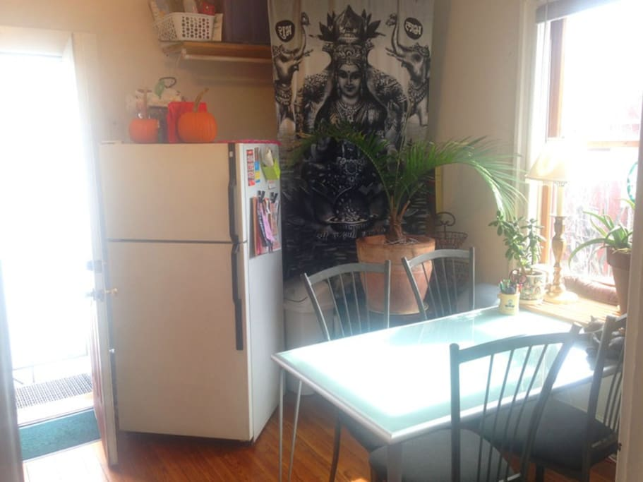 Sunny eat-in kitchen, with door to the fire escape patio.