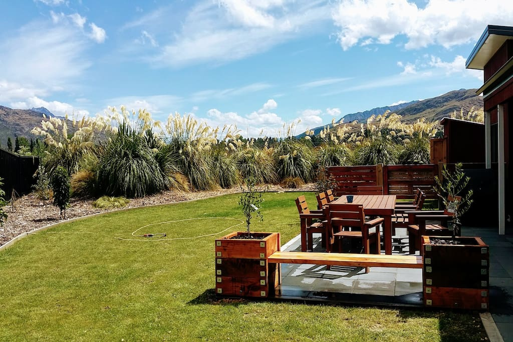 Sunny backyard with privacy, outdoor seating, BBQ, views
