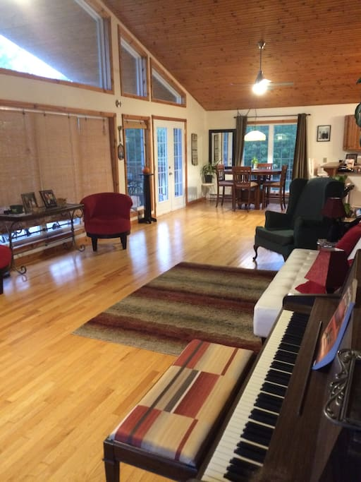 Sit and read or play piano while enjoying the bright, sun- drenched room