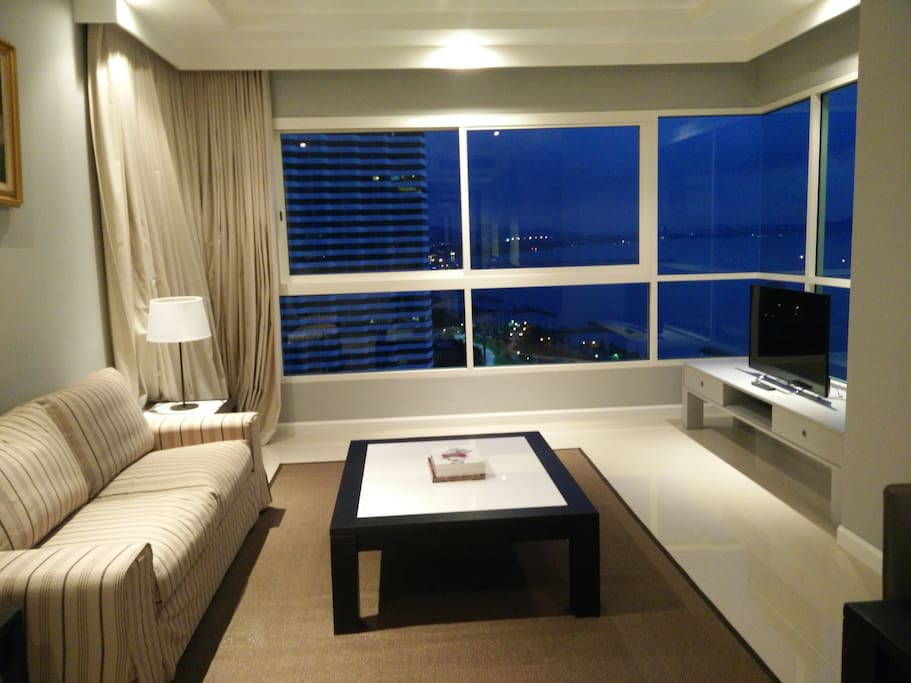 View of ocean and marina from living room and dining room. A beautiful  sight.Very comfortable sofa to relax and watching TV or family gathering and modern designed  dining  room.