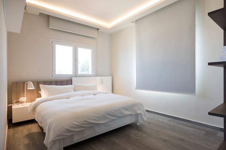Second bedroom with queen bed, mountain view. Photo view from bedroom door entrance.