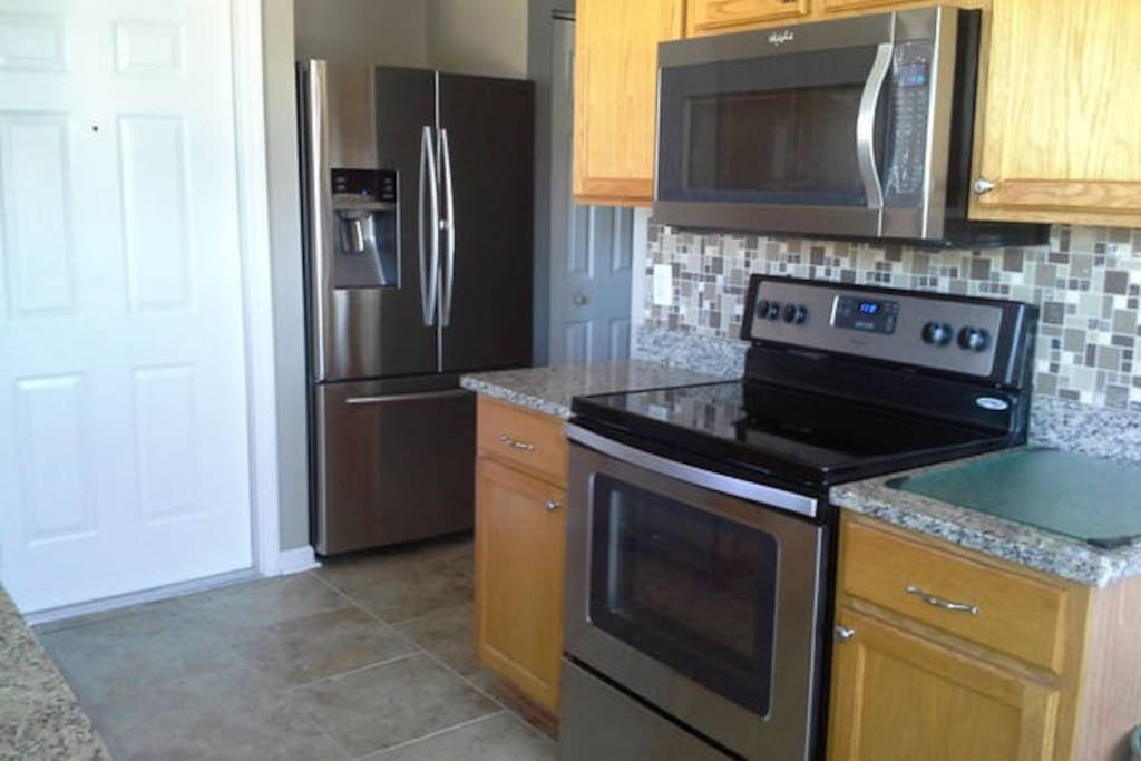 Oak Finish Cabinets w/Brand New Stainless Steel Appliances