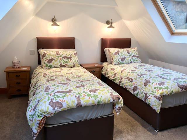Upstairs bedroom, Weavers Cottage, Kildonan Farm Cottages.
