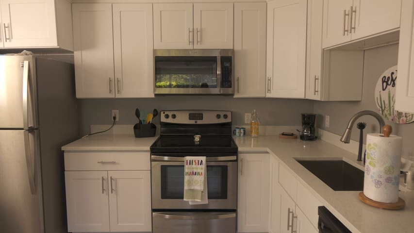 Brand new appliances with  pots, pans, and even table settings.