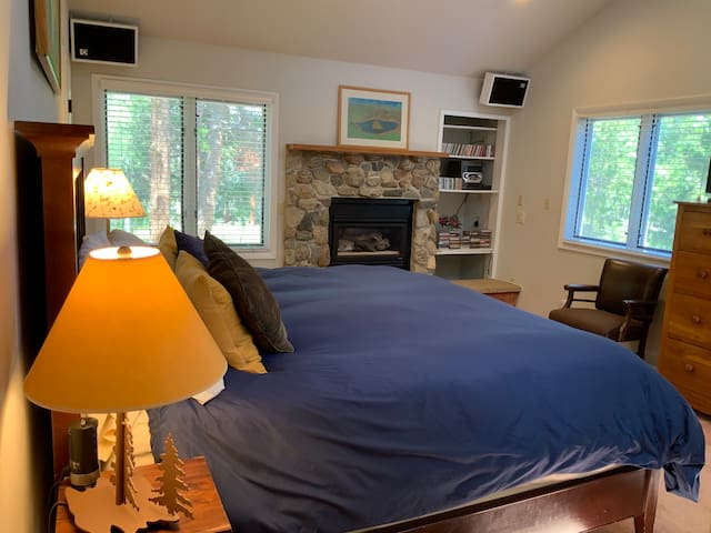 Master bed room with gas fireplace to keep you cozy.