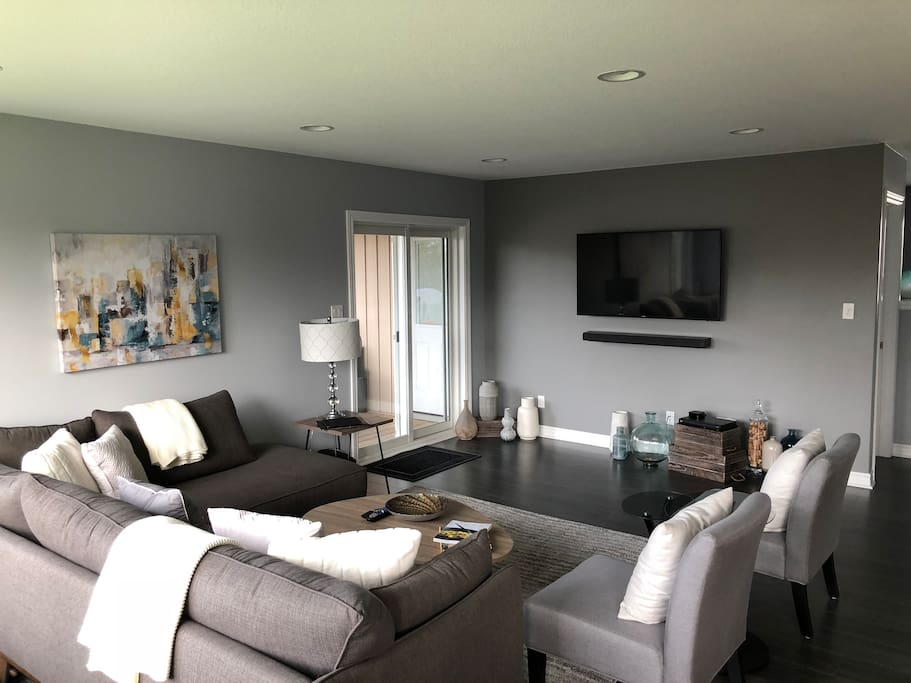 Upstairs living room with cozy seating and flat screen TV equipped with cable and Apple TV. Great spot for catching up with friends and family.