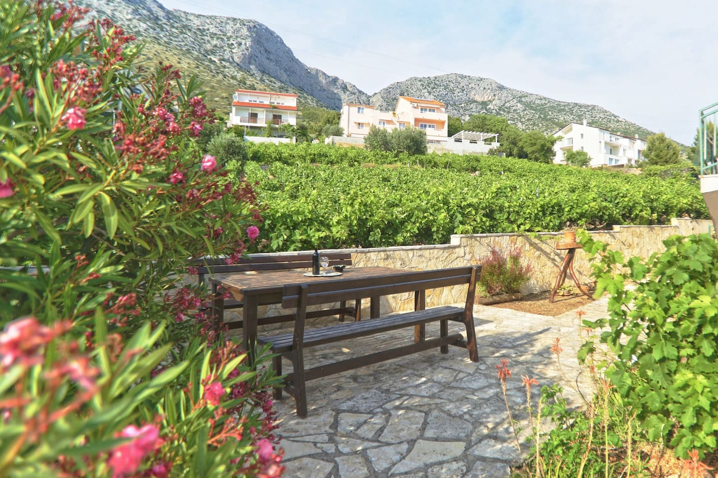 Sit and relax by Oleander tree and enjoy your barbeque made in Dalmatian open-air fireplace..