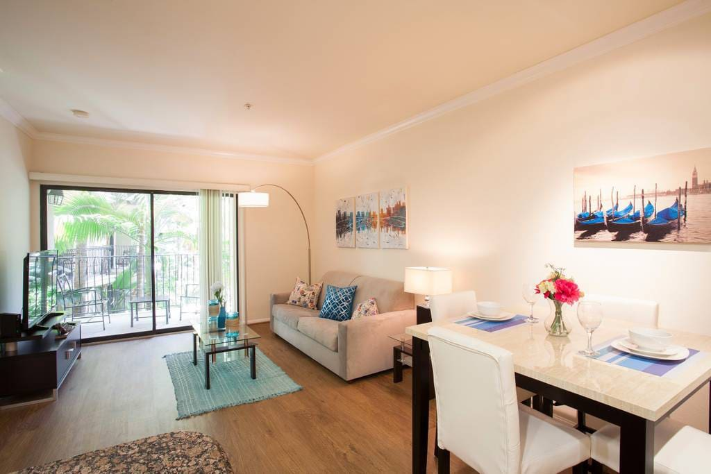 Spacious living room with attached private balcony.