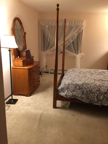Warm and cozy queen size bed with lots of floor space