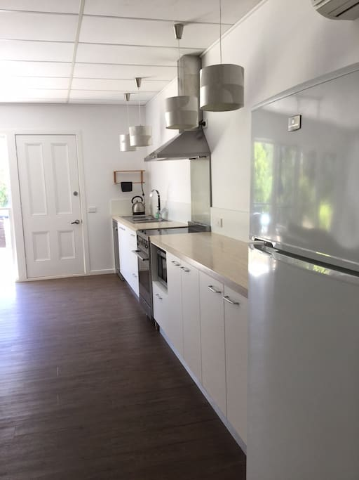 Gorgeous fully equipped modern kitchen with microwave AND dishwasher.