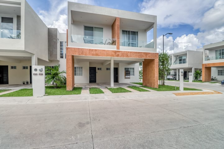 Modern villa in a quiet location w/ strong WiFi, AC & shared pool/garden!
